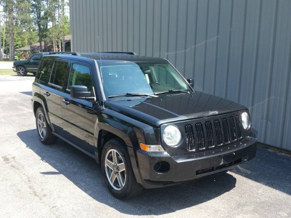 2009 JEEP PATRIOT ! ONE OWNER ! CLEAN CARFAX ! 5 SPEED !LOW MILES !4X4