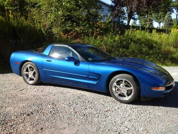 2002 vette -black leather interior - blu see thru top