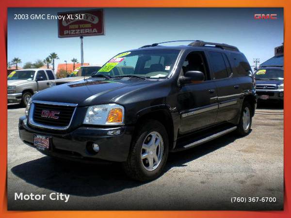 This 2003 GMC Envoy XL SLT SUV w/ 3rd row seat is simply ELEGANT.