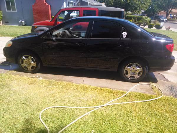 TOYOTA COROLLA CE 04 BLACK NEWER PAINT ELDELY DRIVEN