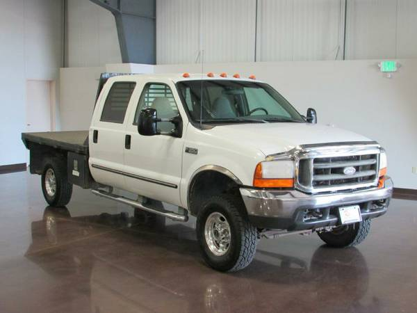 1999 Ford crew cab F 350 4X4 flatbed V 10 gas 6 speed