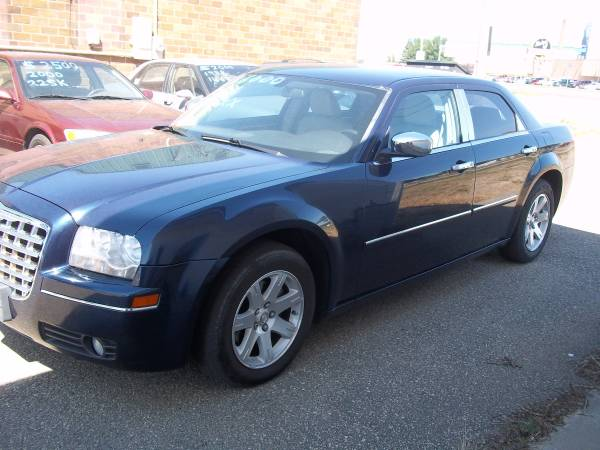 Chrysler 2006 300 Touring (135K mi) leather, heated seats, runs great.