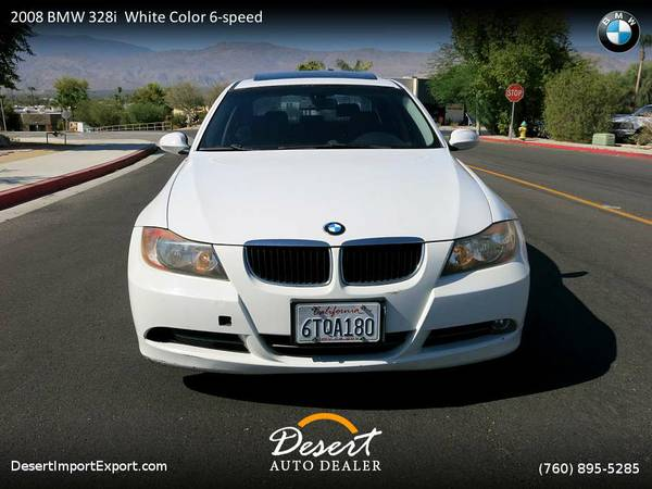 This 2008 BMW 328i White Color 6-speed manual transmission Sedan is...