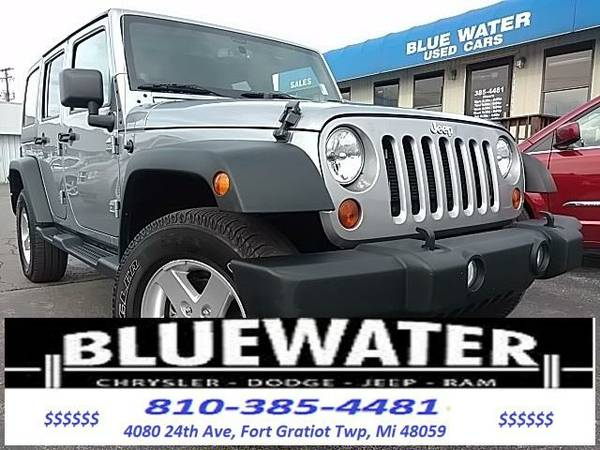 2013 *Jeep Wrangler* Unlimited Sport - Silver