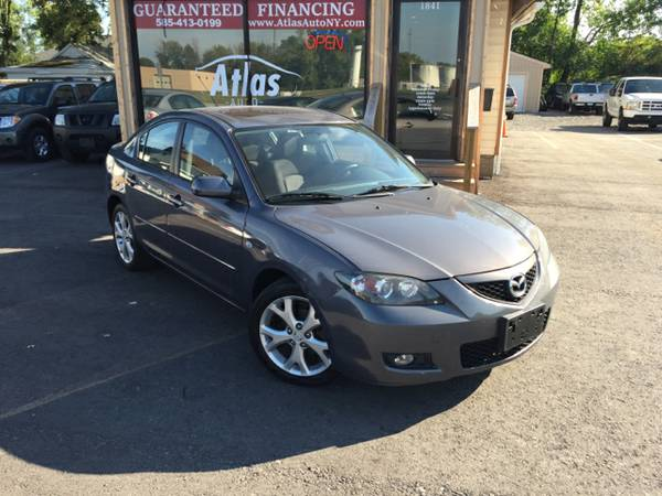 2009 Mazda 3 4 cyl. Gas saver Clean Certified Guaranteed Financing...!