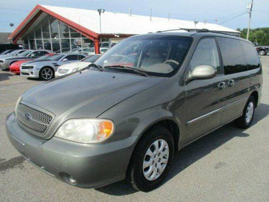 MINIVANS WE HAVE TOYOTA SIENNA KIA SEDONA CHRYSLER TOWN AND COUNTRY