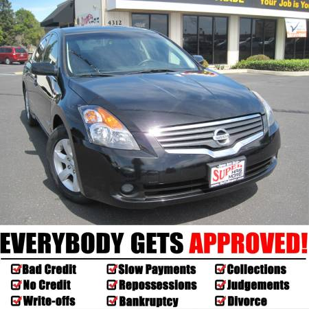 *$995 Down Gets You This 2009 Nissan Altima Hybrid Black!