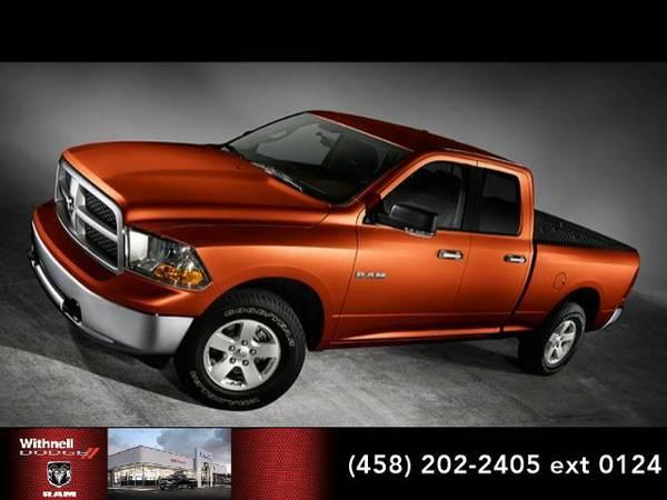 2010 *Dodge Ram 1500* 4WD Quad Cab 140.5 SLT (SILVER)