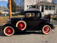 1930 Ford Model A coupe with spare tire & rumble seat