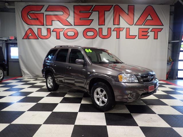 Photo 2006 Mazda Tribute 3.0L V6 4X4 AFFORDABLE SUV LOW MILES FOR THE YEAR