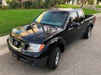 2009 Nissan Frontier 4x2 XE King Cab 4dr 5M