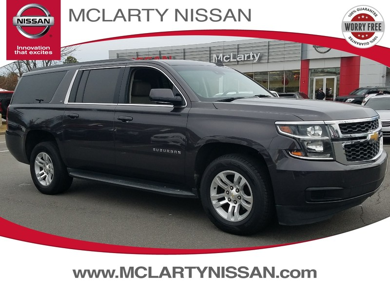 Photo Pre-Owned 2015 CHEVROLET SUBURBAN 2WD 4DR LT Rear Wheel Drive Sport Utility Vehicle