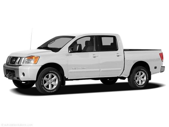 Photo Pre-Owned 2011 Nissan Titan Truck Crew Cab in Jacksonville FL