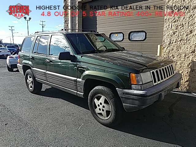 Photo Pre-Owned 1995 Jeep Grand Cherokee SE 4WD