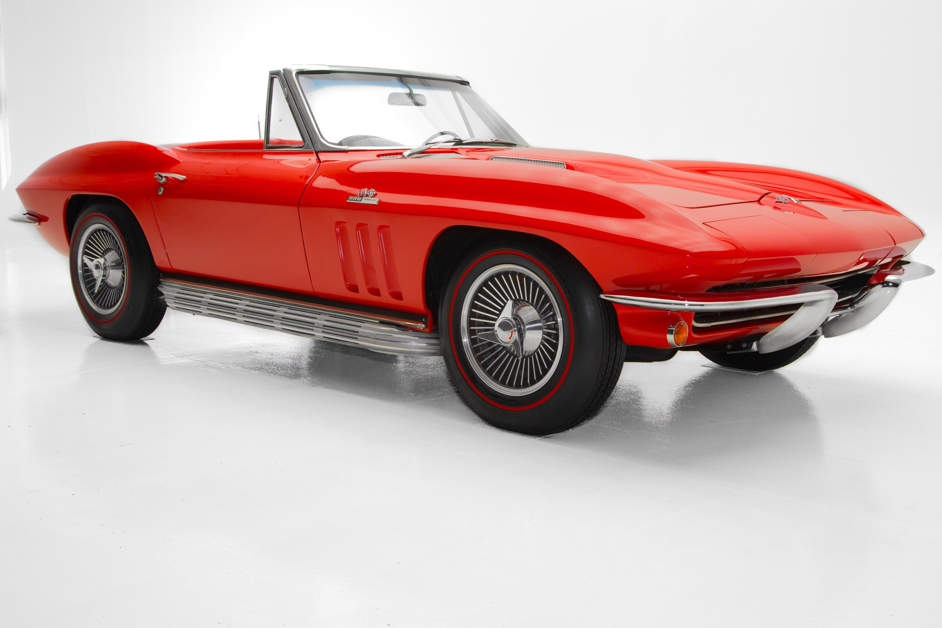 Photo 1965 Chevrolet Corvette Rally Red Roadster, 454, 4 Speed, AC, Knockoffs