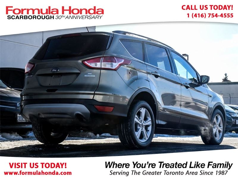 Photo Pre-Owned 2014 Ford Escape 100 PETROCAN CARD NEW YEARS SPECIAL FWD Sport Utility