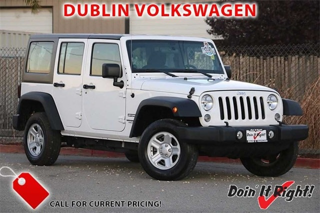 Photo Pre-Owned 2014 Jeep Wrangler Unlimited Unlimited Sport SUV in Dublin, CA