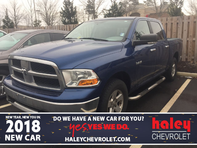 Photo PRE-OWNED 2009 DODGE RAM 1500 SLT WITH THE RAM BOX 4WD