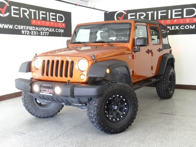 Photo 2010 Jeep Wrangler Unlimited UNLIMITED SPORT TRAIL RATED 4WD RUNNING BOARDS LIFT KIT TOW HOOKS AUTOMATIC