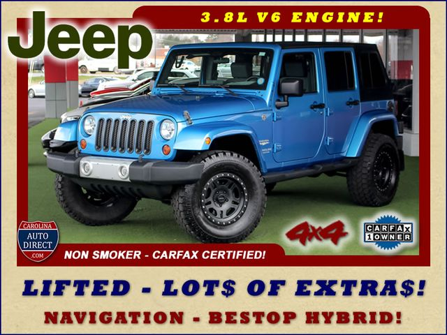 Photo 2010 Jeep Wrangler Unlimited Sahara 4X4 - NAV - LIFTED - EXTRA