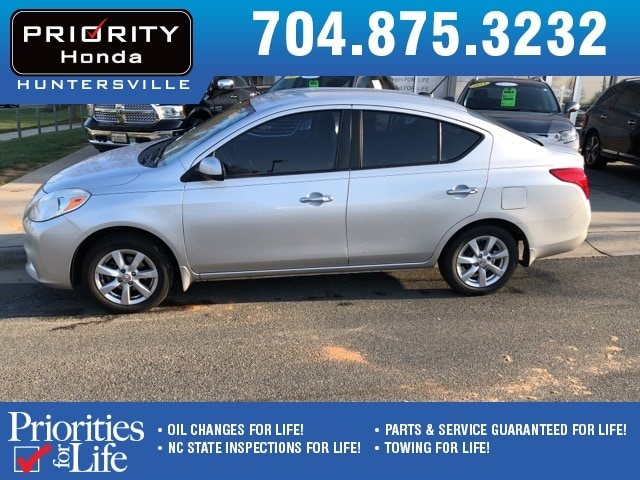 Photo Used 2012 Nissan Versa For Sale in Huntersville NC  Serving Charlotte, Concord NC  Cornelius. VIN 3N1CN7APXCL879276