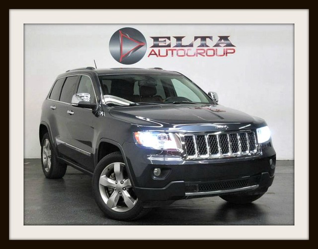 Photo 2013 Jeep Grand Cherokee OVERLAND  4WD  HEMI  LEATHER  PANO-ROOF  1 OWNER