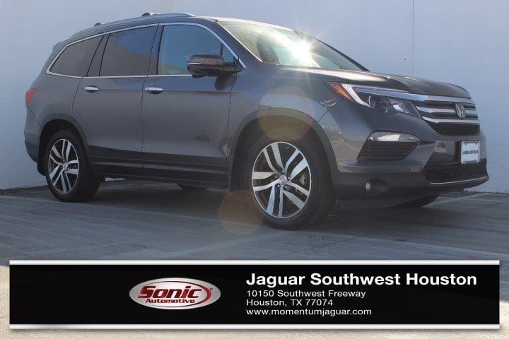 Photo Used 2016 Honda Pilot Touring 2WD 4dr wRES  Navi in Houston