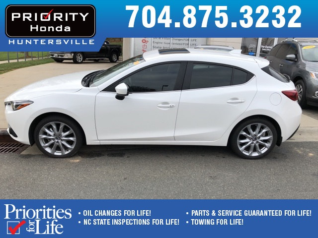 Photo Used 2014 Mazda Mazda3 For Sale in Huntersville NC  Serving Charlotte, Concord NC  Cornelius. VIN JM1BM1M3XE1189927
