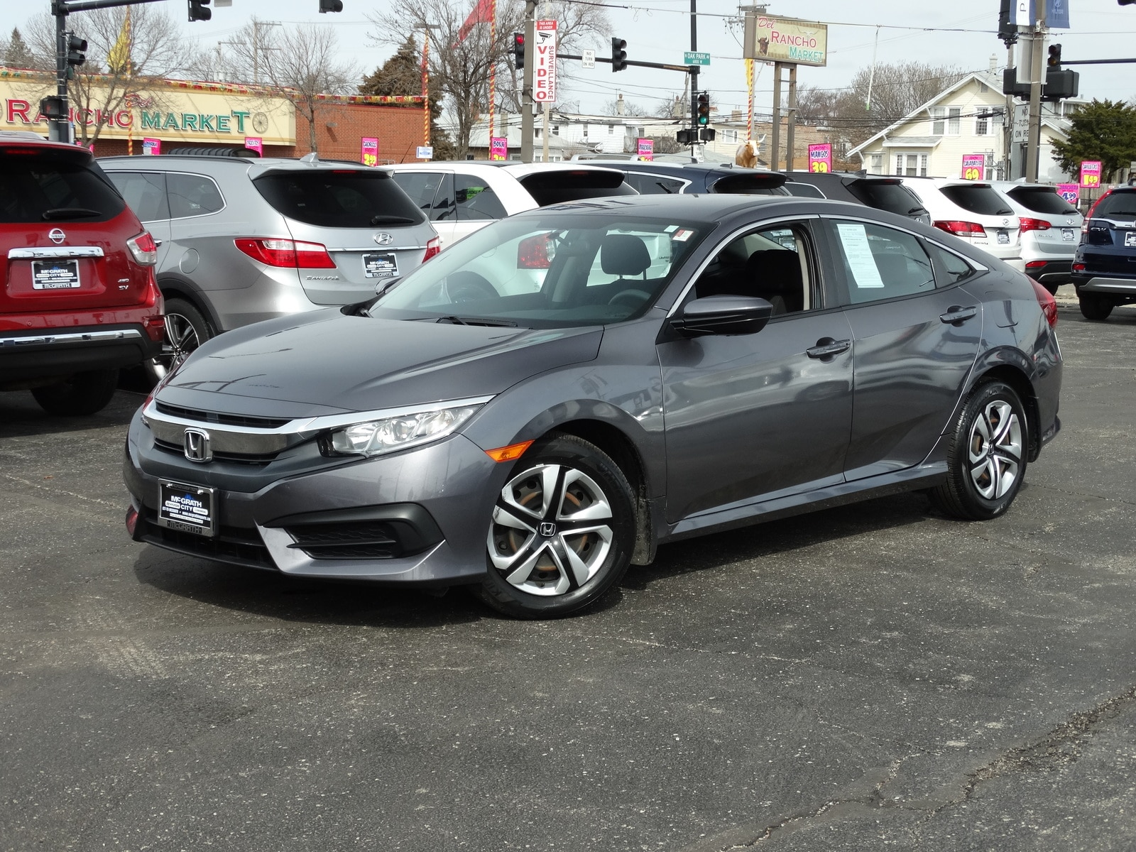 Photo Used 2016 Honda Civic CVT LX Sedan Automatic Front-wheel Drive in Chicago, IL
