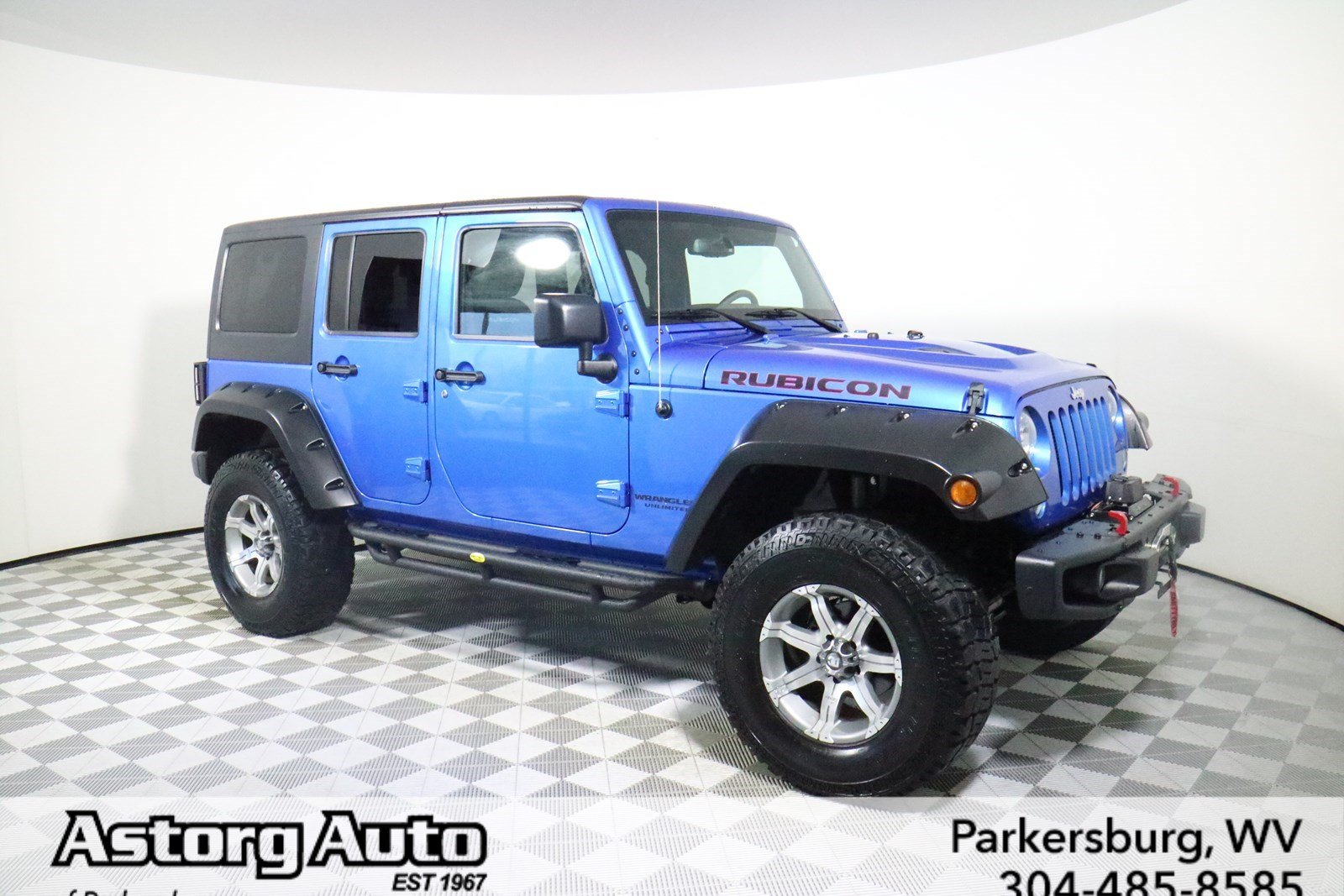 Photo PRE-OWNED 2015 JEEP WRANGLER UNLIMITED RUBICON HARD ROCK 4WD