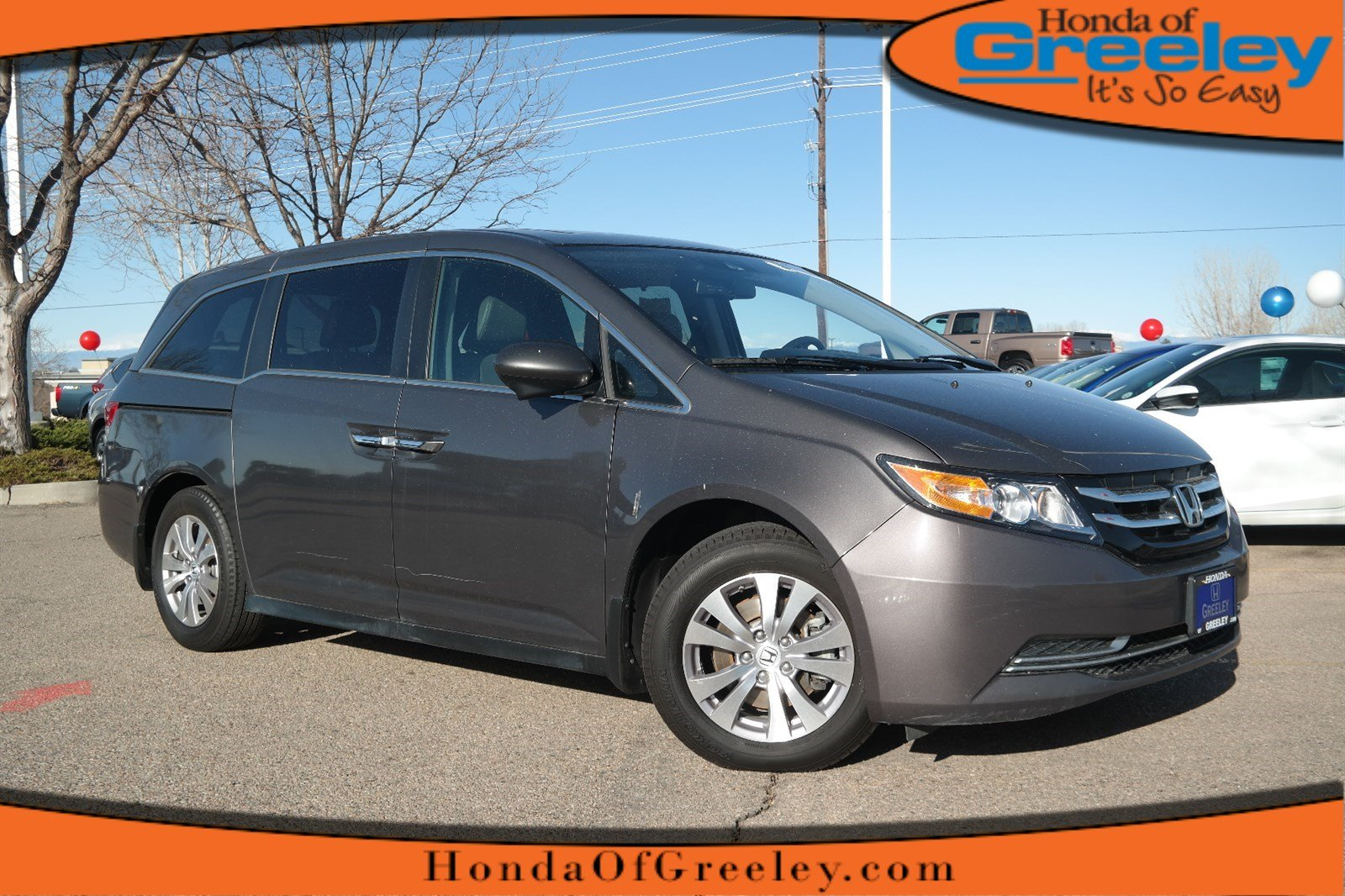 Photo Pre-Owned 2015 Honda Odyssey EX-L Front Wheel Drive Mini-van, Passenger For Sale in Greeley, Loveland, Windsor, Fort Collins, Longmont, Colorado