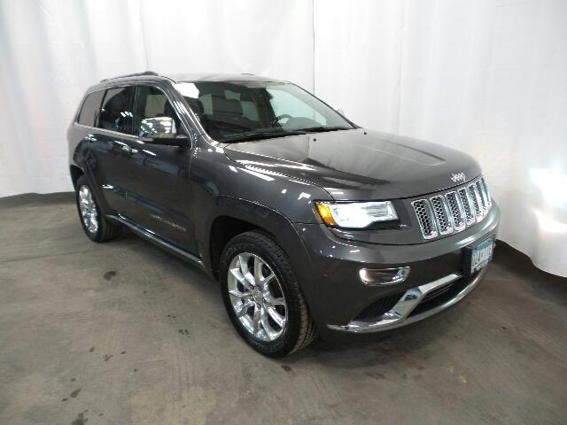 Photo CERTIFIED PRE-OWNED 2014 JEEP GRAND CHEROKEE 4WD 4DR SUMMIT WITH NAVIGATION  4WD