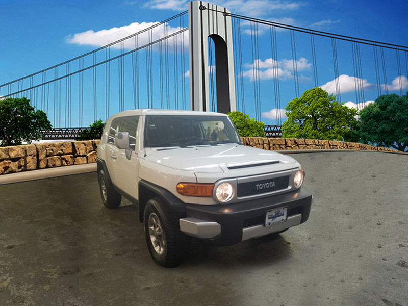 Photo Pre-Owned 2012 Toyota FJ Cruiser 4WD 4dr Auto LIFETIME WARRANTY INCLUDED Four Wheel Drive SUV