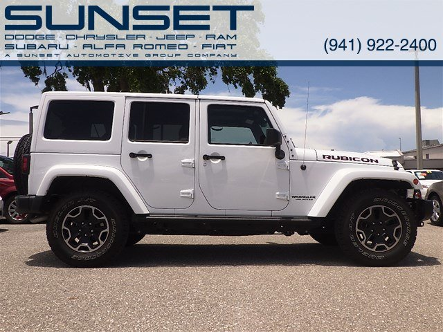Photo Used 2016 Jeep Wrangler Unlimited Rubicon Hard Rock SUV for sale in Sarasota FL
