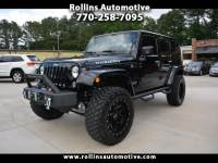 2016 Jeep Wrangler Unlimited Rubicon Lifted. Many options. Both Tops