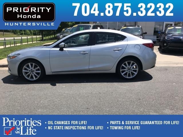Photo Used 2017 Mazda Mazda3 For Sale in Huntersville NC  Serving Charlotte, Concord NC  Cornelius. VIN JM1BN1V7XH1106421