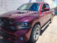 PRE-OWNED 2014 RAM 1500 4WD CREW CAB 140.5 SPORT 4WD
