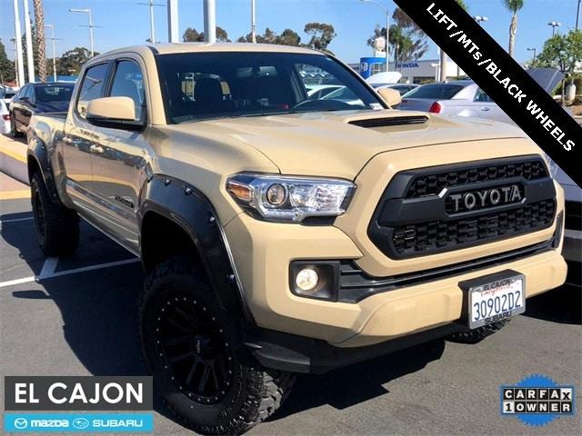 Photo Used 2017 Toyota Tacoma TRD Sport WLift  18 Black Wheels For Sale San Diego  3TMBZ5DN5HM008198