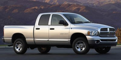Photo Pre-Owned 2005 Dodge Ram 1500 4dr Quad Cab 160.5 WB SLT Rear Wheel Drive Pickup Truck