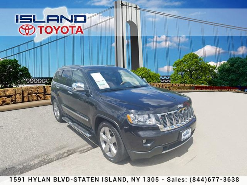 Photo Pre-Owned 2013 Jeep Grand Cherokee 4WD 4dr Overland LIFE TIME WARRANTYT Four Wheel Drive SUV