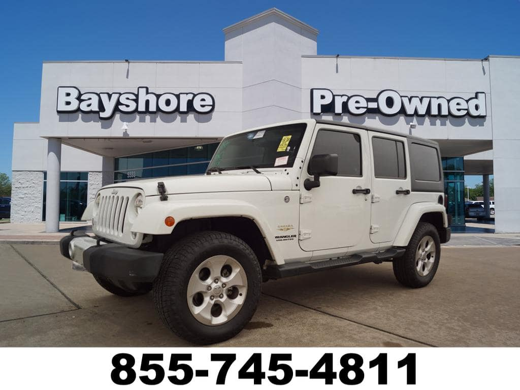 Photo 2015 Jeep Wrangler Unlimited 4WD Sahara 4x4 w Hardtop and CD SUV in Baytown, TX Please call 832-262-9925 for more information.