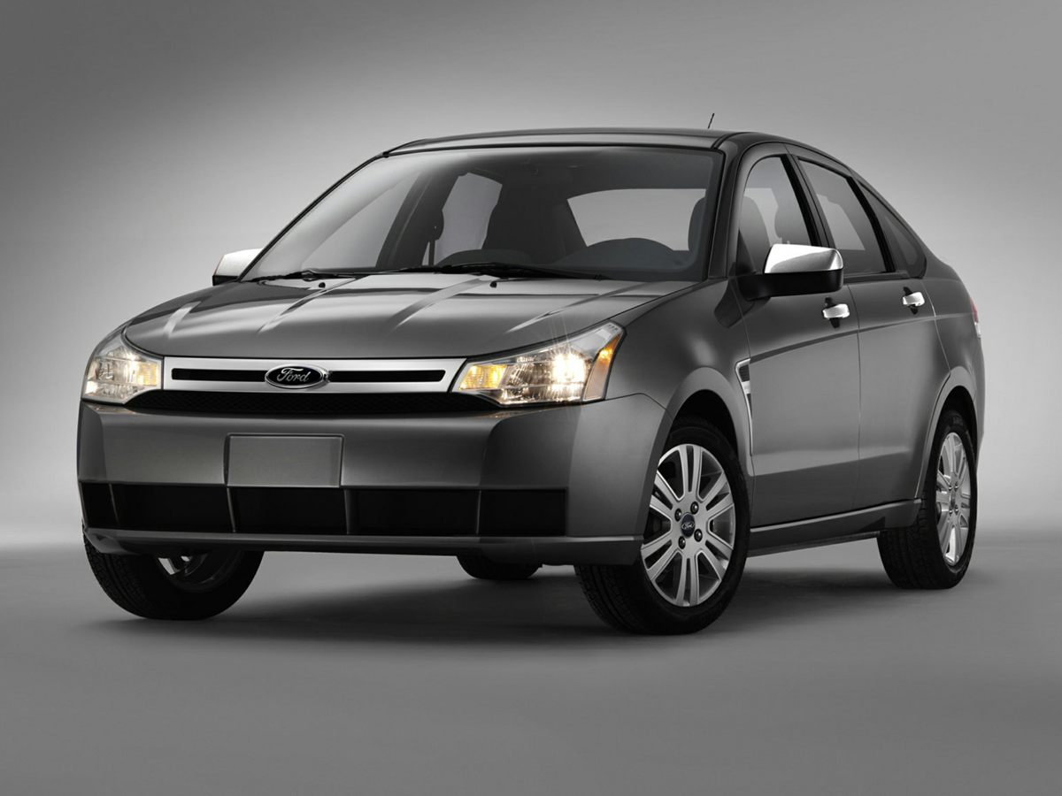 Photo Used 2011 Ford Focus SES Sedan FWD For Sale in Houston