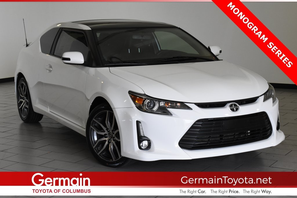 Photo Pre-Owned 2014 Scion tC Base FWD 2dr Car