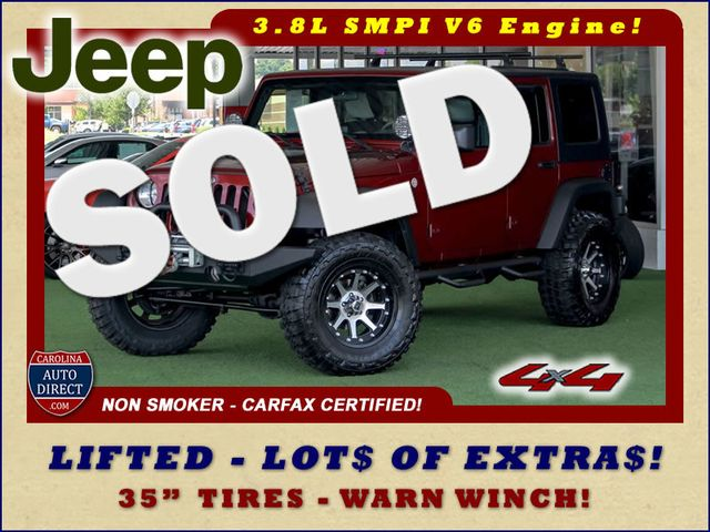Photo 2010 Jeep Wrangler Unlimited Sport 4x4 - LIFTED - LOT OF EXTRA