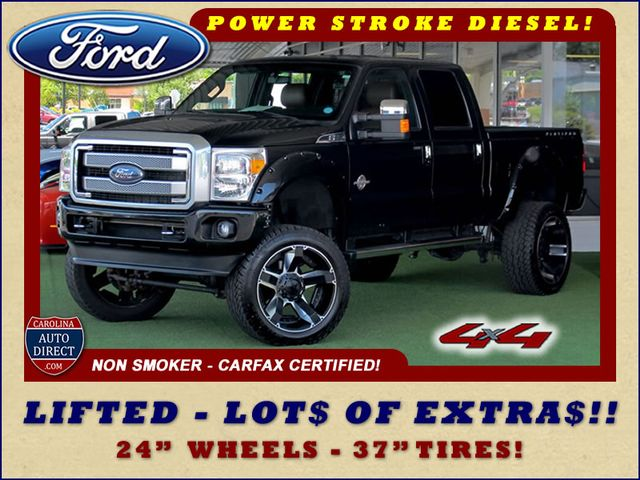 Photo 2014 Ford Super Duty F-250 Pickup Platinum Crew Cab 4x4 - LIFTED - LOT OF EXTRA