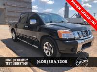 Pre-Owned 2009 Nissan Titan SE RWD 4D Crew Cab