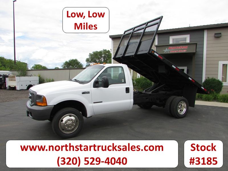 Photo Used 1999 Ford F-450 Flat Bed Dump Truck