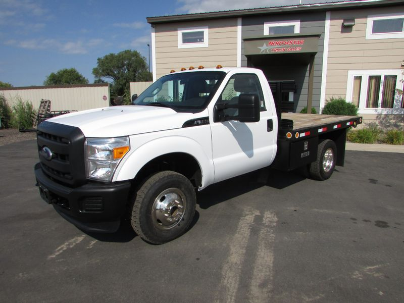 Photo Used 2011 Ford 2011 Ford F-350 4x4 Flat-Bed Truck