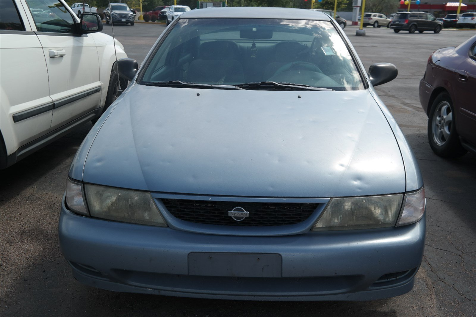 Photo Pre-Owned 1998 Nissan Sentra XE Front Wheel Drive 4dr Car