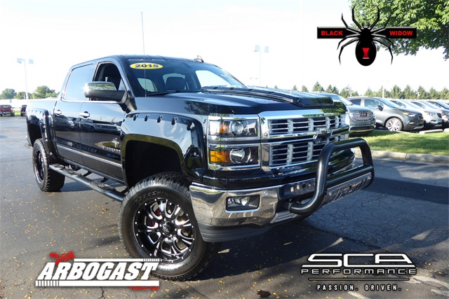 Photo Pre-Owned 2015 Chevrolet Silverado 1500 Black Widow Lifted Truck 4WD